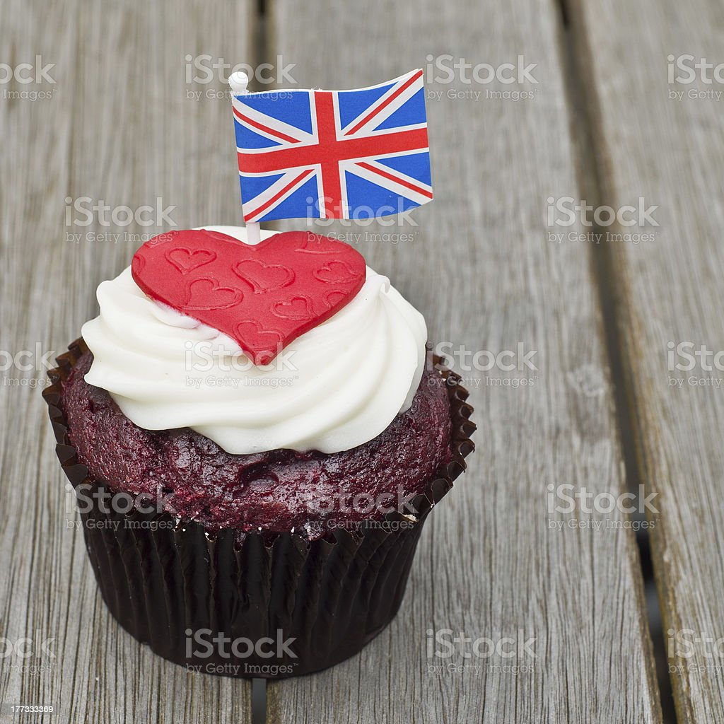 A chocolate cupcake with a love heart topped off with the union jack...