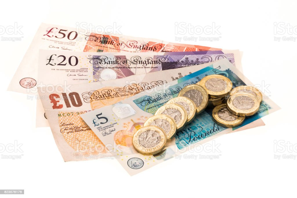 British currency banknotes and one pound coins stock photo