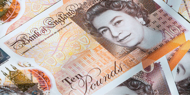 British Currency - Cash London, UK: July 25, 2018: British ten pound banknote with a portrait of Queen Elizabeth II. New 2017 issue designed to deter counterfeiting, the note is polymer and waterproof. ten pound note stock pictures, royalty-free photos & images