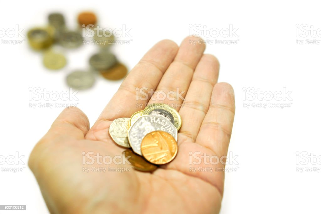 British currency coins on hand stock photo