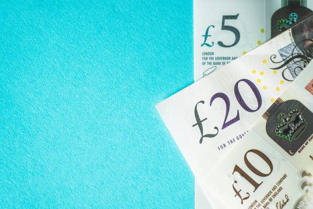British currency Brisitsh currency bills with a blue space british currency stock pictures, royalty-free photos & images