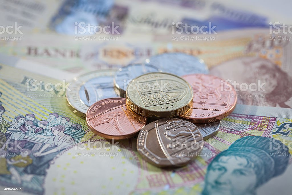 British Currency Pile of Coins on Notes stock photo