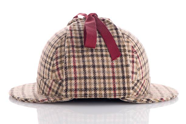 British Deerhunter or Sherlock Holmes cap British Deerhunter or Sherlock Holmes cap on white background. deerstalker hat stock pictures, royalty-free photos & images