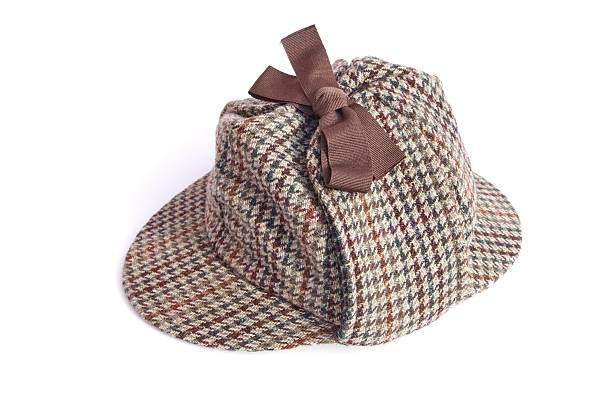 British Deerstalker Hat Or Cap Isolated On White British Deerstalker or Sherlock Holmes cap  Isolated on white deerstalker hat stock pictures, royalty-free photos & images