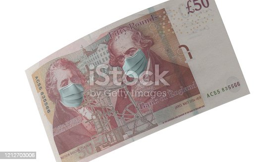 British Fifty Pound Note with surgical mask. Protection from Coronavirus on economy. High resolution image for all crop sizes. White background.