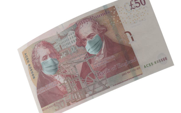 British Fifty Pound Note with Mask Protection For Coronavirus on Economy Against White Background British Fifty Pound Note with surgical mask. Protection from Coronavirus on economy. High resolution image for all crop sizes. White background. uk stock pictures, royalty-free photos & images