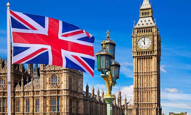 british flag, big ben and houses of parliament. london - london england stock photos and pictures