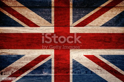 British flag painted on grungy wooden background.
