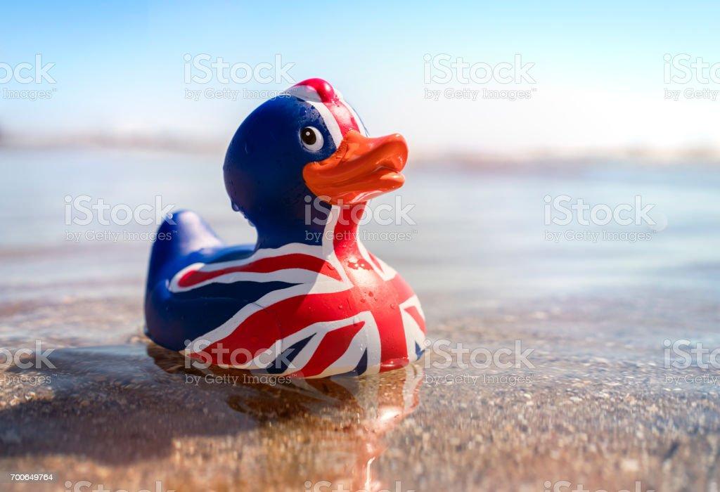 British flag rubber duck in the sea stock photo