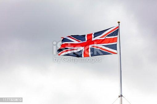 British Flag Union Jack against dark clouds