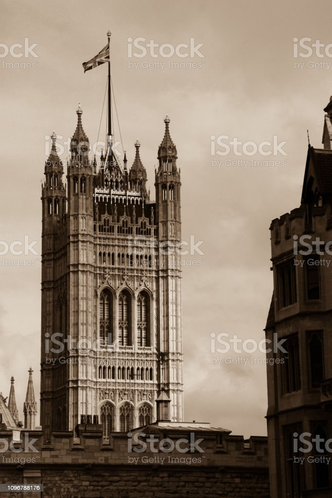 British flag waving on top of the Victoria Tower at the Westminster Palace in London, United Kingdom stock photo