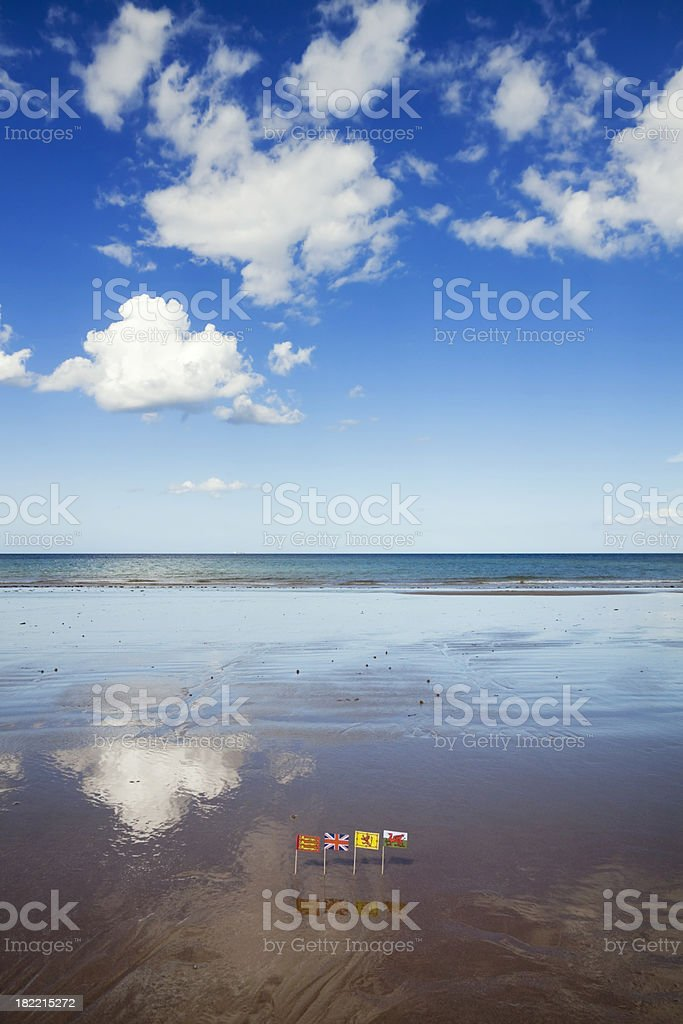 British flags in wet sand, with reflections royalty-free stock photo