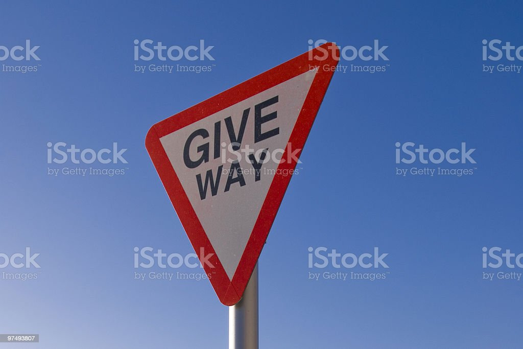 British Give Way Road Sign against Blue Sky royalty-free stock photo