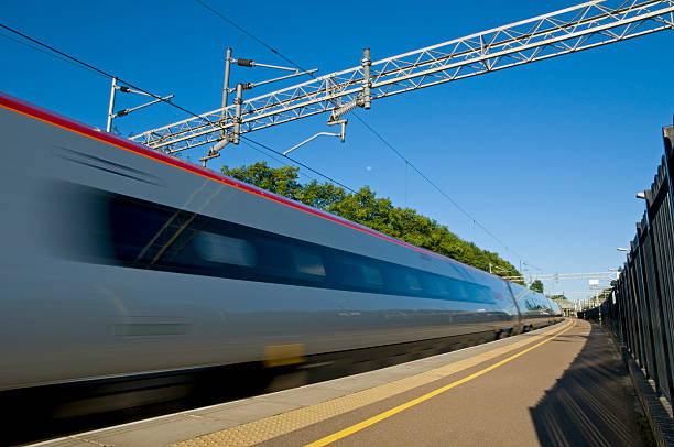 British High Speed Train A British high speed passenger train passing through a station in the early morning. bullet train stock pictures, royalty-free photos & images