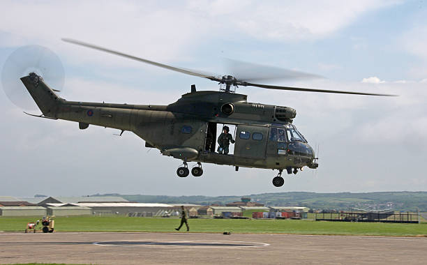 british military puma helicopter carrying troops - uk military stock photos and pictures