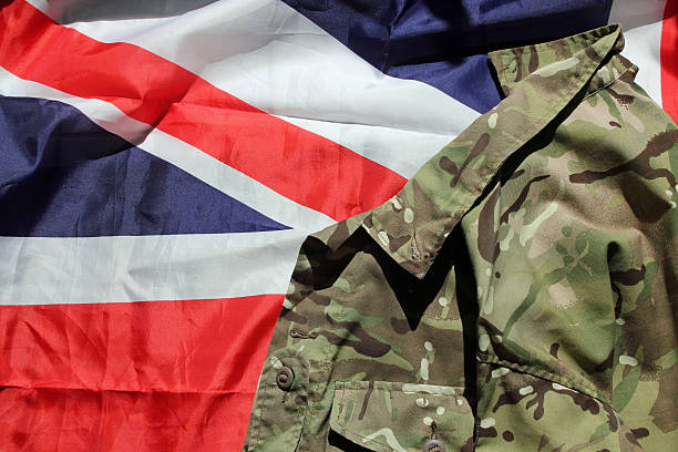 british military uniform and the union flag - uk military stock photos and pictures