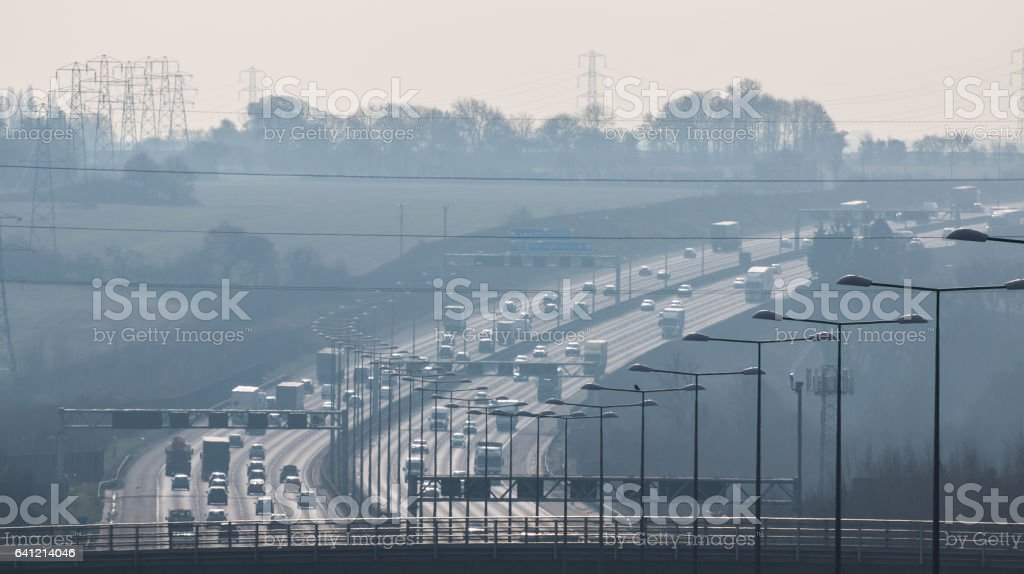 British motorway in a rush hours, in a foggy afternoon stock photo