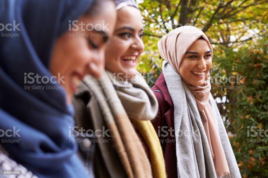 British Muslim Female Friends Meeting In Urban Environment stock photo