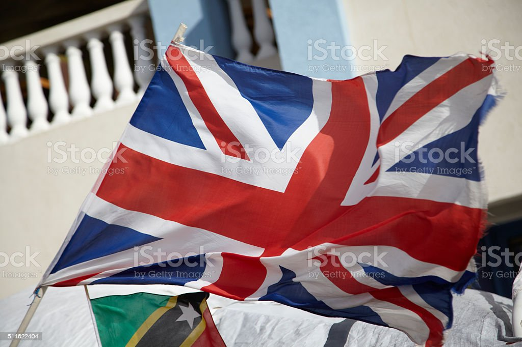 British Nevis & St Kitts flag blowing in wind stock photo