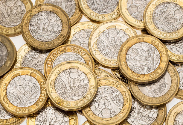 British one pound coins background A background of British one pound coins one pound coin stock pictures, royalty-free photos & images