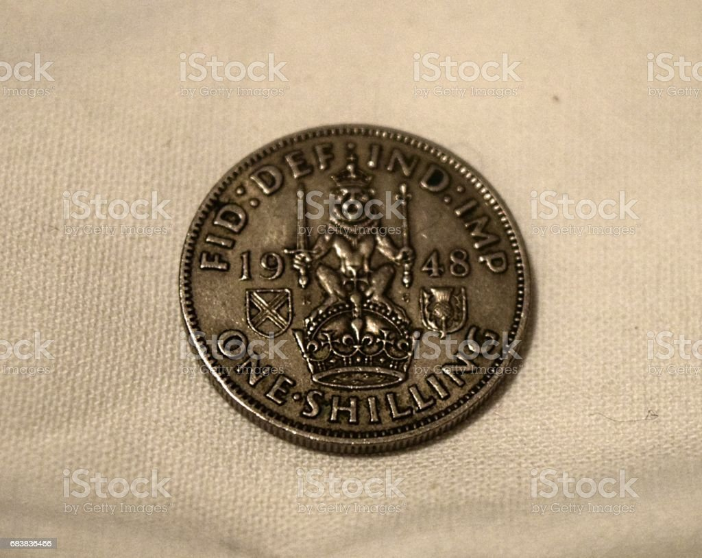 British one shilling 1948  coin  money close up stock photo