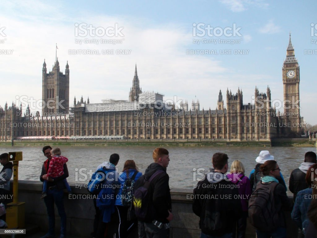 British Palace Of Westminster London,Thames River,Lots Of Tourists Standing In UK stock photo