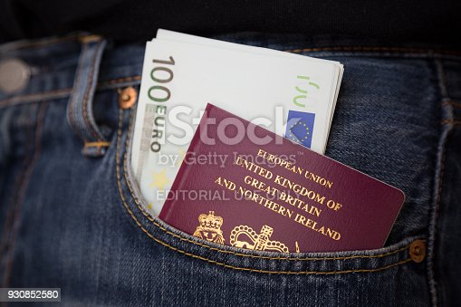 istock british passport and Euros 930852580