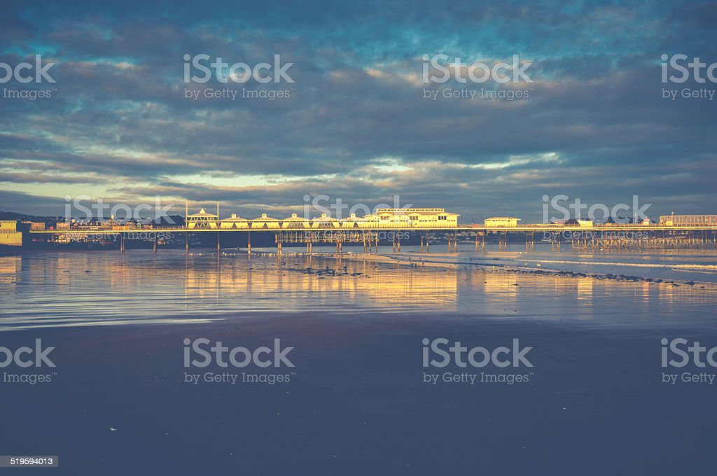 British pier in Paignton at sunset with sky background stock photo