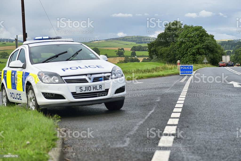 British police car parked at the side of the road stock photo