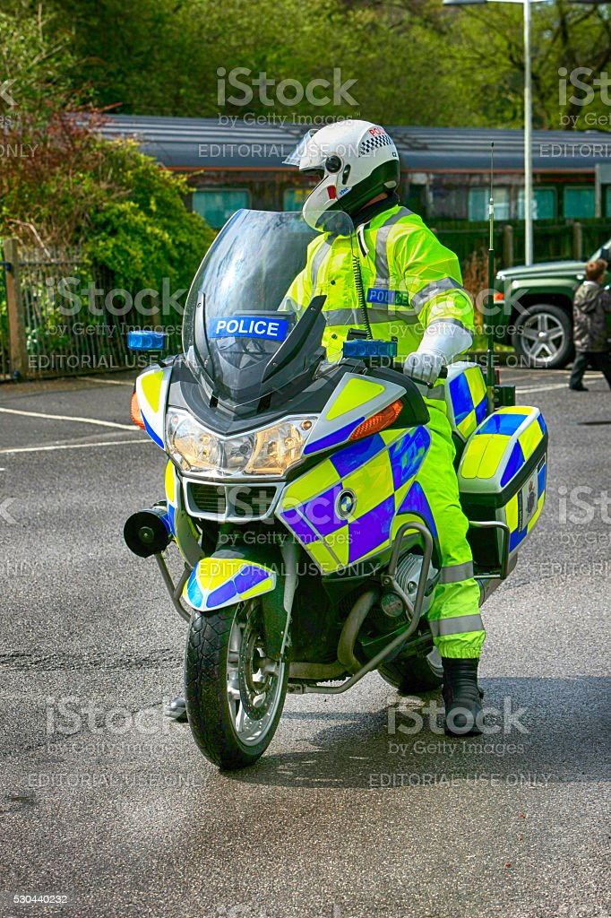British Police motorcyclist on his bike just outside London stock photo