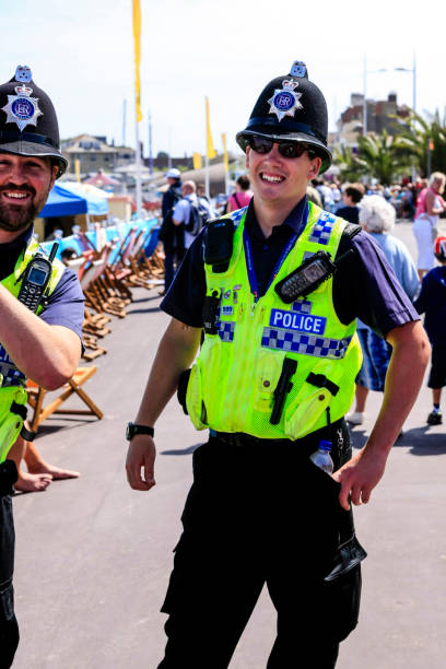British Police officers patrol the seafront at Weymouth in Dorset UK stock photo