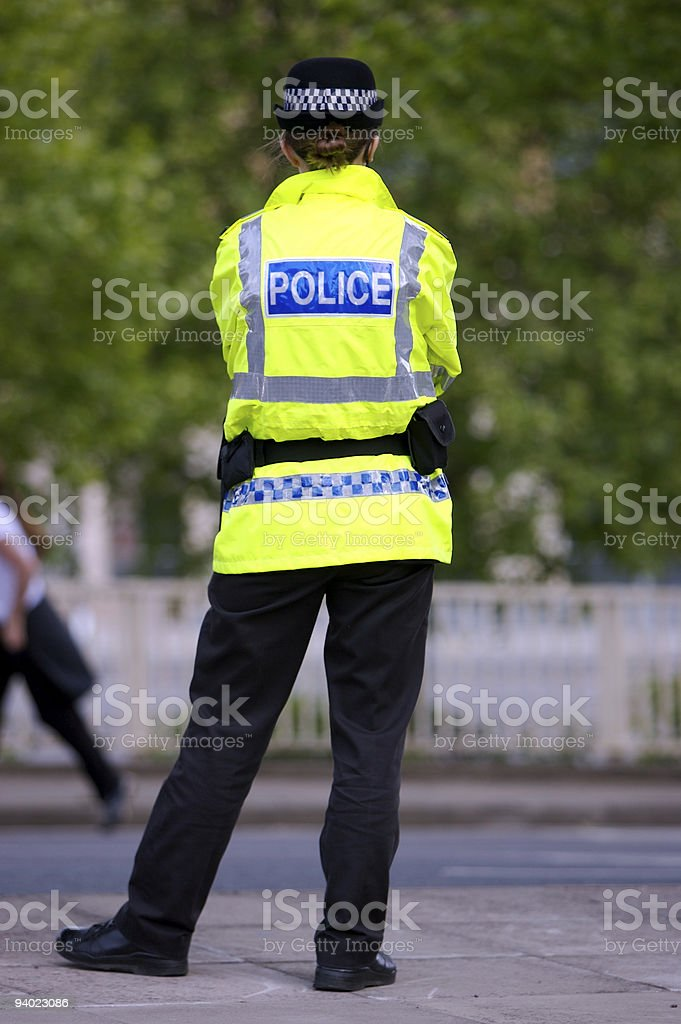 British Police Woman on duty stock photo