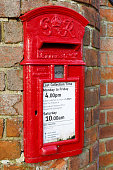 Buckingham, UK - January 16, 2016. A traditional British post box is set into a wall in Buckinghamshire. The post box dates from the reign of George VI from 1936 to 1952.
