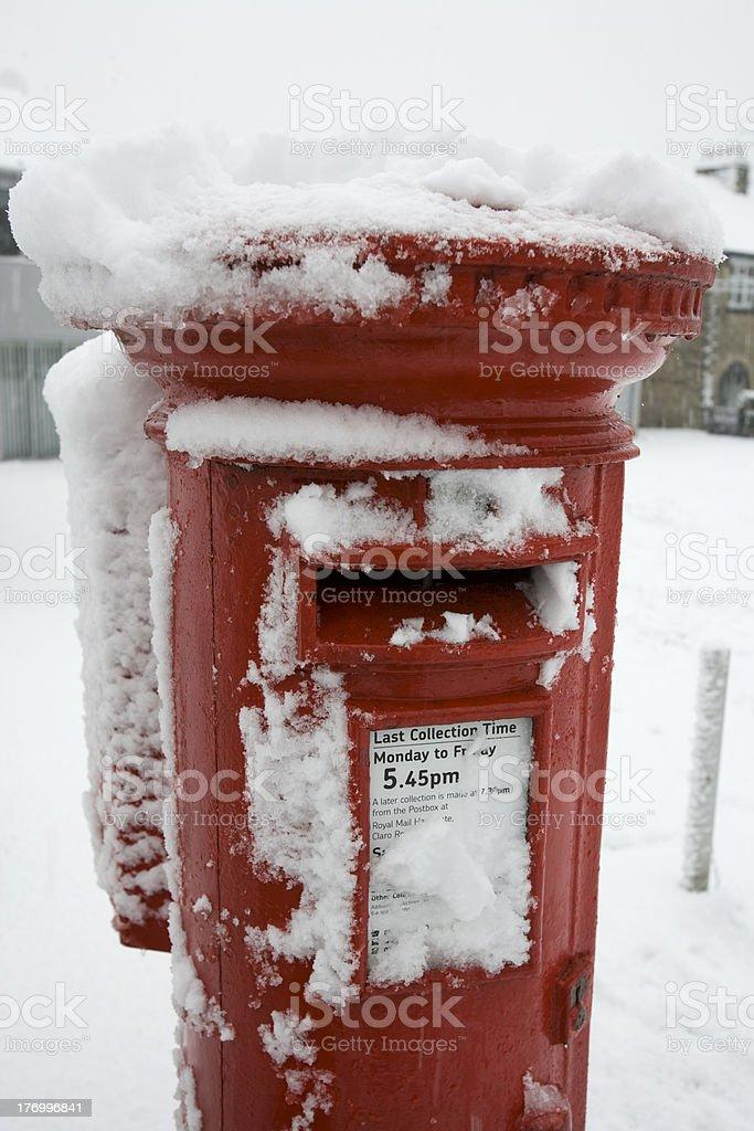 British post box in snow royalty-free stock photo
