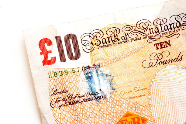 British pound banknotes British pound banknotes ten pound note stock pictures, royalty-free photos & images
