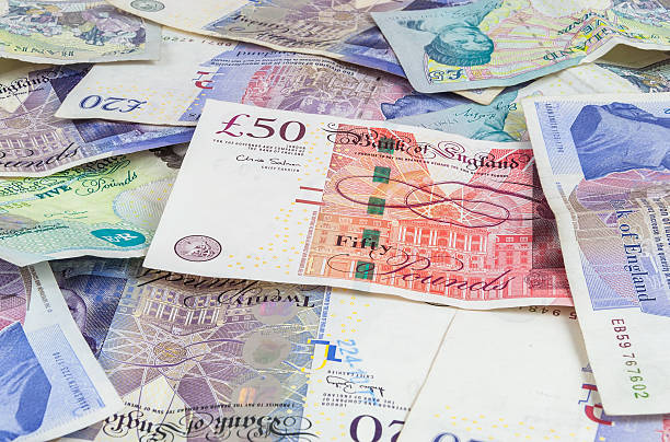 British pounds banknotes background Background made of english pounds banknotes - pile of money british currency stock pictures, royalty-free photos & images