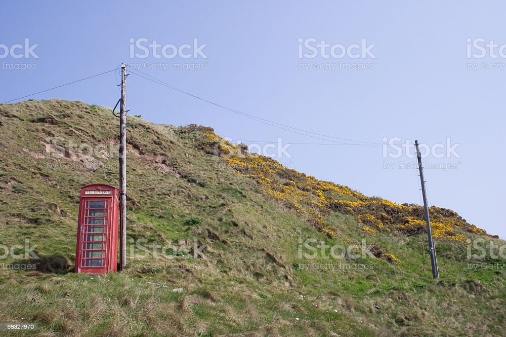 British red telephone box on hillside royalty-free stock photo