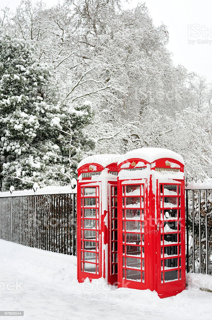British red telephone boxes in the snow royalty-free stock photo