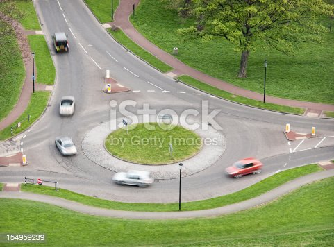 Motion blur as cars turn on a roundabout in the UK.