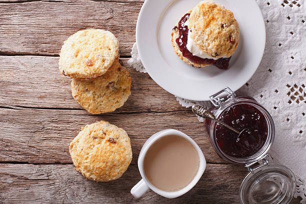british scones with jam and tea close-up. horizontal top view - scone bildbanksfoton och bilder