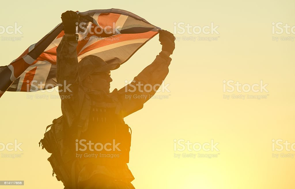 British Soldier with UK Flag stock photo