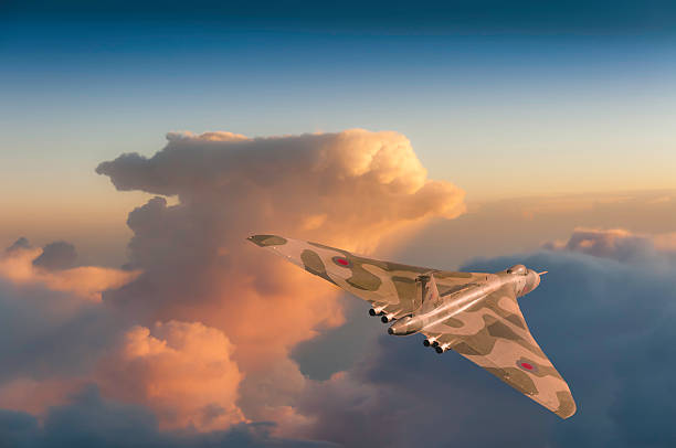 British Strategic Bomber British strategic bomber climbing into a stormy dawn sky. bomber plane stock pictures, royalty-free photos & images
