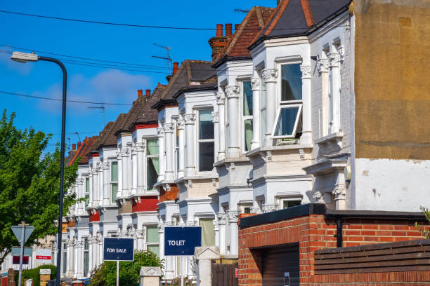 British terraced houses in London with estate agent boards A row of typical British terraced houses around Kensal Rise in London with estate agent boards house rental stock pictures, royalty-free photos & images