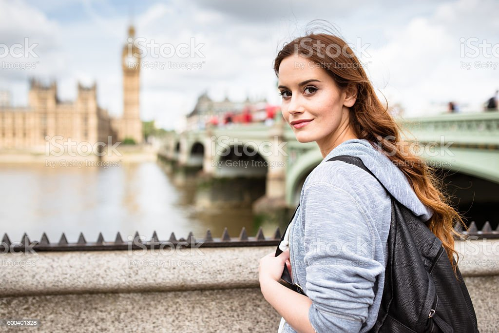 british tourist in london smiling against the Big Ben stock photo