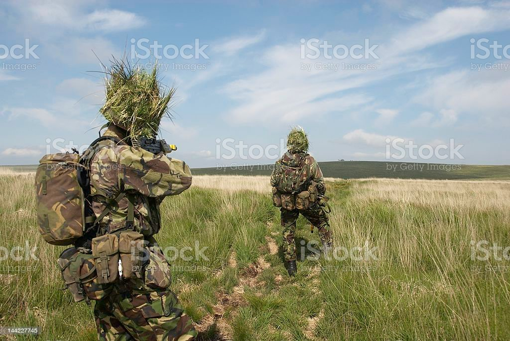 British troops watch as helicopter evacuates casualty stock photo