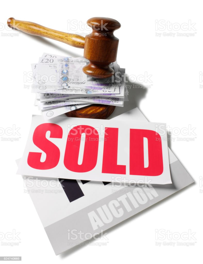 British Twenty Pound Notes under a Gavel and Sold Sign stock photo