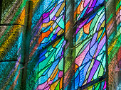 Stained glass church window located in the town of Locronan in the Brittany area of France