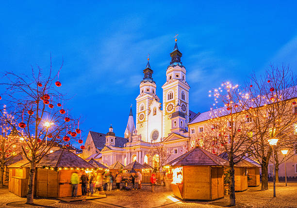 Brixen - Christmas Market in South Tyrol Christmas Market in front of the Brixen´s cathedral (Duomo di Bressanone) in South Tyrol. trentino alto adige stock pictures, royalty-free photos & images