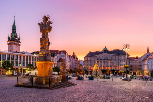 Brno city Brno, Czech Republic - August 23, 2017: Cabbage Market square and Holy Trinity Column in the old town of Brno in Moravia. brno stock pictures, royalty-free photos & images