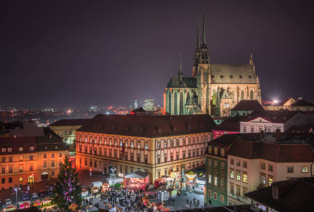 Brno Cityscape with Christmas Market at Night, Czech Republic Old Town with Christmas Market and Cathedral of St. Peter and Paul in Brno, Czech Republic as Seen from City Hall Tower at Night brno stock pictures, royalty-free photos & images